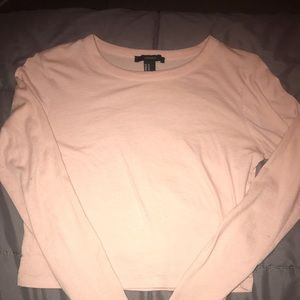 Two light pink crop tops !